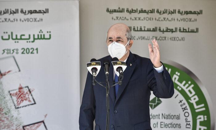 Algeria's President Abdelmadjid Tebboune speaks outside a polling station in Bouchaoui, on the western outskirts of Algeria's capital Algiers, on June 12, 2021. (Ryad Kramdi/AFP via Getty Images)