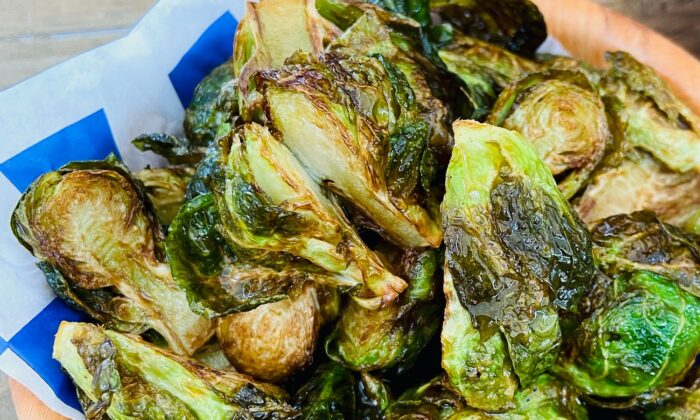 Tossing Brussels sprouts in a vinaigrette before roasting takes them to a whole new level. (Kary Osmond/TNS)