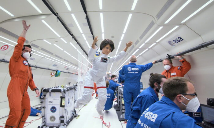 A Barbie doll version of an Italian astronaut Samantha Cristoforetti is seen during a zero-gravity flight with members of the European Space Agency in an unknown location.  (Courtesy of ESA/Simone Marocchi/Handout via Reuters)