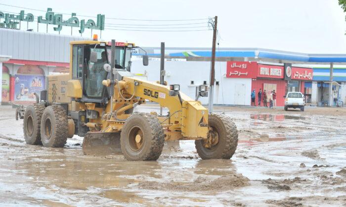 Workers repair damages caused by Cyclone Shaheen in Al Musanaa, Al Batina region, Oman, on Oct. 4, 2021(Oman News Agency/Handout via Reuters)