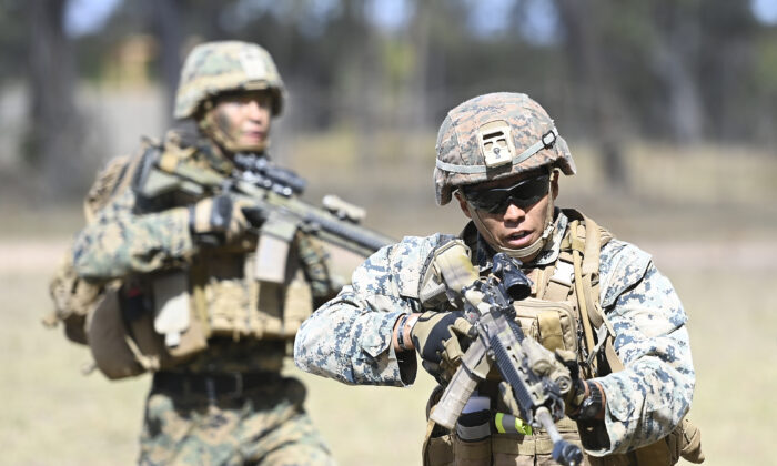 U.S Marines from MRF-D (Marine Rotaional Force Darwin) participate in an Urban assault as part of Exercise 'Talisman Sabre 21' in Townsville, Australia, on July 27, 2021.  (Ian Hitchcock/Getty Images)
