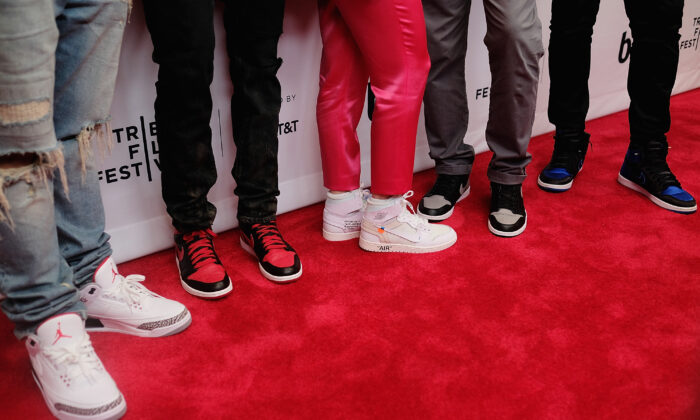 """Guests pose in their Air Jordan Sneakers at the screening of """"Unbanned: The Legend of AJ1"""" at the 2018 Tribeca Film Festival at Beacon Theatre on April 27, 2018 in New York. (Nicholas Hunt/Getty Images)"""