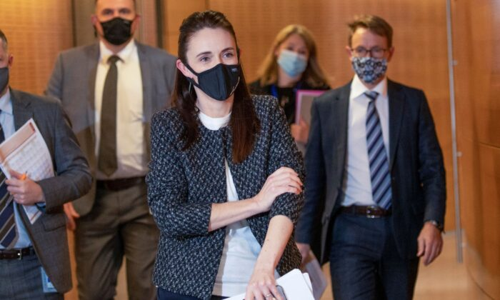 New Zealand Prime Minister Jacinda Ardern arrives with director general of health Dr Ashley Bloomfield (R) for the post-Cabinet press conference at Parliament in Wellington, New Zealand, on Oct. 4, 2021. (Mark Mitchell/Pool Photo via AP)