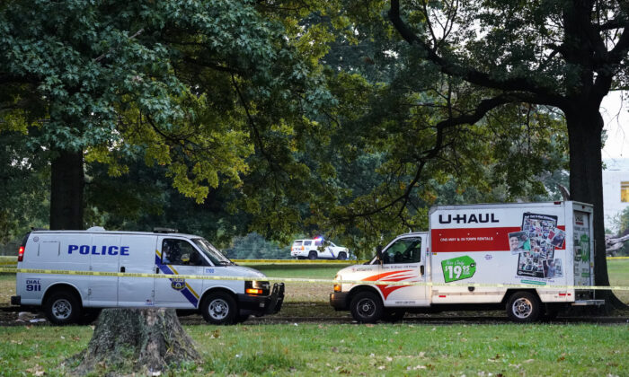 Police vehicles and a U-Haul truck are shown at a crime scene in Philadelphia, on Oct. 4, 2021. (Matt Rourke/AP Photo)