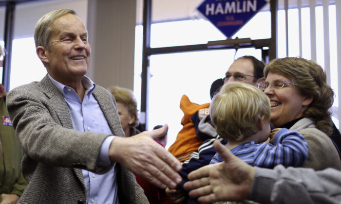 Todd Akin, then a Missouri Republican Senate candidate, campaigns in Florissant, Mo., on Nov. 5, 2012. (Jeff Roberson/AP Photo)