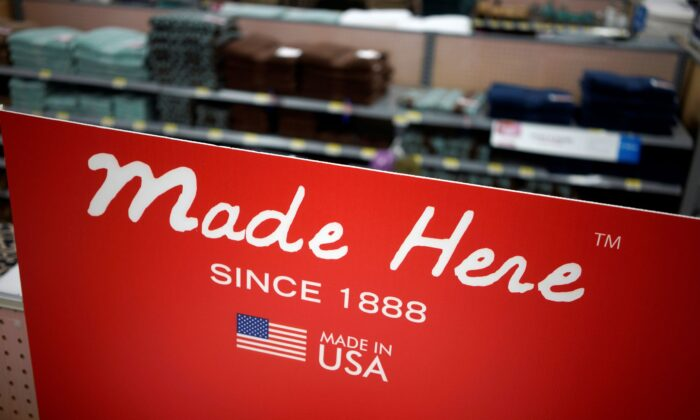 A sign advertising towels made in the United States is seen at the Walmart Supercenter in Bentonville, Ark., on June 5, 2014. (Rick Wilking/Reuters)