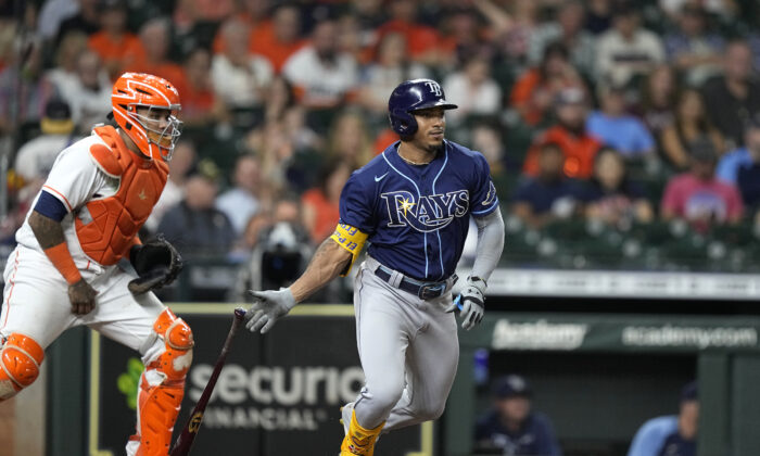 Tampa Bay Rays' Wander Franco, right, hits into a force out as Houston Astros catcher Martin Maldonado watches during the fourth inning of a baseball game in Houston on Sept. 30, 2021. (David J. Phillip/AP Photo)