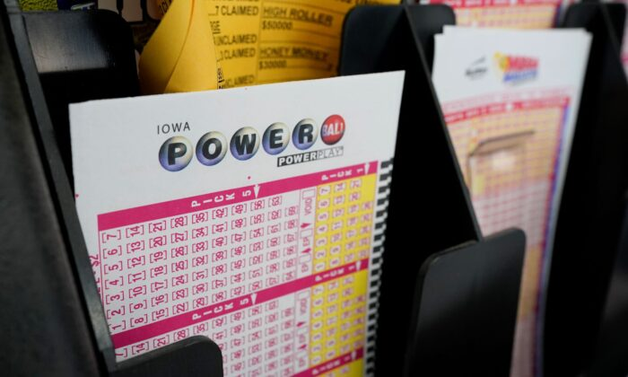 Blank forms for the Powerball lottery sit in a bin at a local grocery store, in Des Moines, Iowa, on Jan. 12, 2021. (Charlie Neibergall/AP Photo)