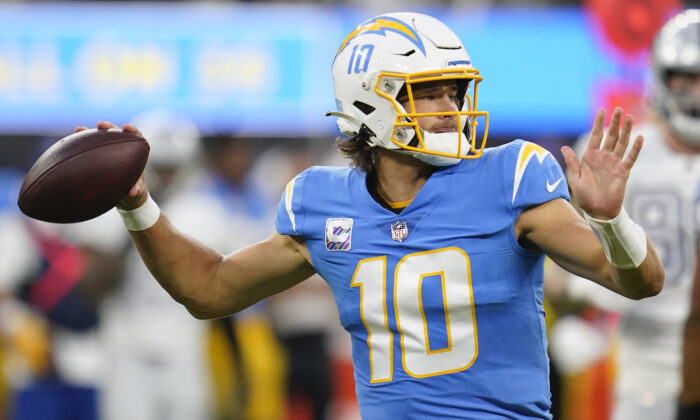 Los Angeles Chargers quarterback Justin Herbert throws a pass during the first half of an NFL football game against the Las Vegas Raiders in Inglewood, Calif., on Oct. 4, 2021. (Ashley Landis/AP Photo)