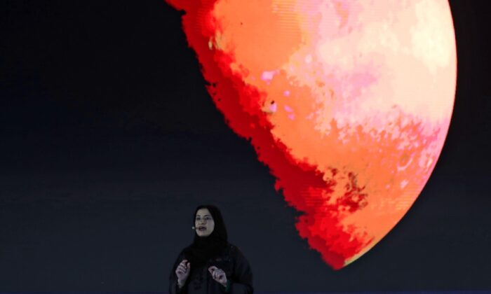 Sarah Al Amiri, Emirati Minister of State for Advanced Sciences and Deputy Project Manager of the Emirates Mars Mission, speaks ahead of a live broadcast of the Hope Probe as it attempts to enter Mars orbit, in Dubai, United Arab Emirates, on Oct. 5, 2021. (Kamran Jebreili/AP Photo)