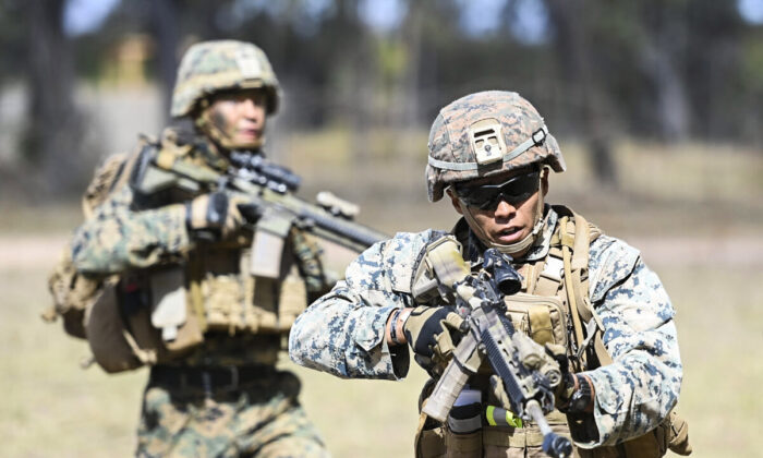 U.S Marines from MRF-D (Marine Rotaional Force Darwin) participate in an Urban assault as part of Exercise 'Talisman Sabre 21' on July 27, 2021 in Townsville, Australia.  Exercise Talisman Sabre 2021 is the largest bilateral training activity held every two years, forces undergo complex warfighting scenarios between Australia and the United States. This year it includes forces from Canada, Japan, Republic of Korea, New Zealand, and the United Kingdom. (Ian Hitchcock/Getty Images)