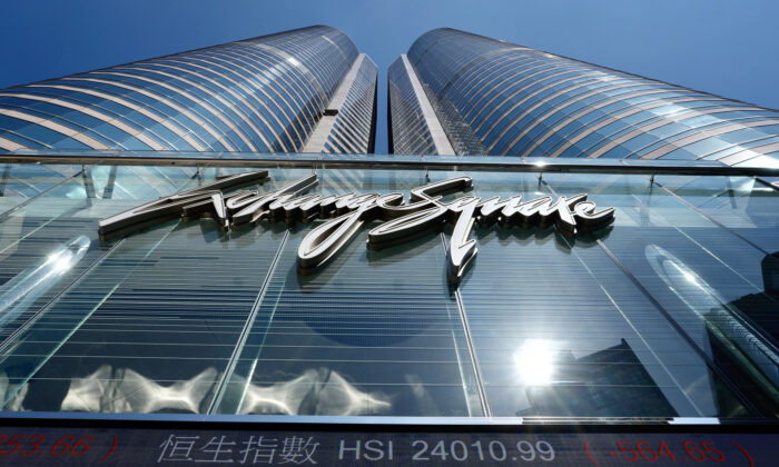 A bank's electronic board displays the Hong Kong share index at Hong Kong Stock Exchange on Oct. 4, 2021. (AP Photo/Vincent Yu)