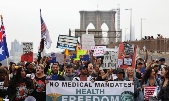 People march as they protest against NYC's COVID-19 vaccine mandate that went into effect today for public school employees in New York City on Oct. 4, 2021. (Michael M. Santiago/Getty Images)