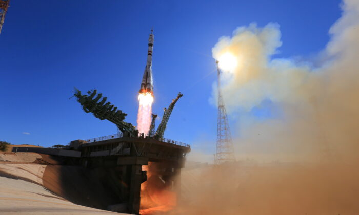 The Soyuz MS-19 spacecraft carrying the crew, formed of Russian cosmonaut Anton Shkaplerov, film director Klim Shipenko and actress Yulia Peresild, blasts off to the International Space Station (ISS) from the launchpad at the Baikonur Cosmodrome, Kazakhstan on Oct. 5, 2021. (Roscosmos/via Reuters)