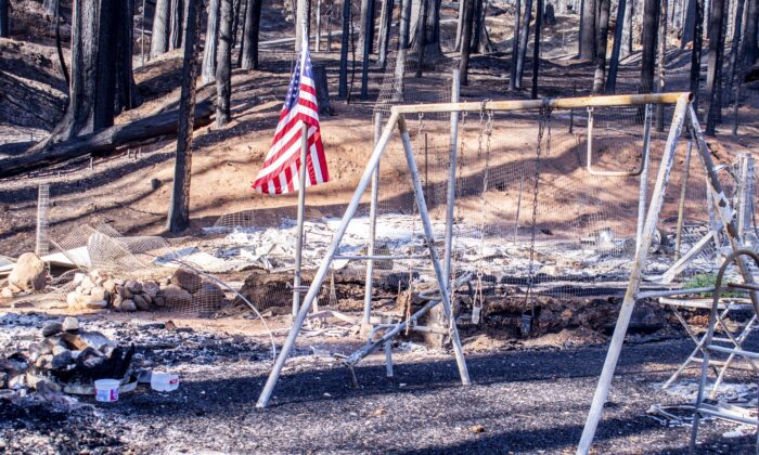 A swing set, burned by the Caldor Fire, in Grizzly Flats on Sept. 26, 2021. (Jacquelin Mullinax/NTD News)