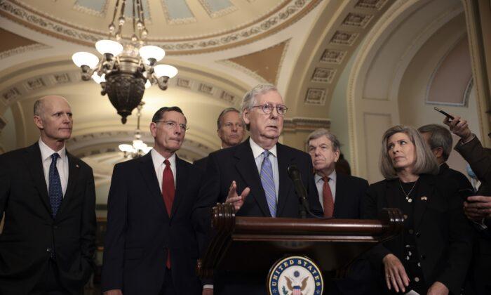 Senate Minority Leader Mitch McConnell (R-Ky.) addresses reporters following a weekly Republican policy luncheon as (L-R) Sen. Rick Scott (R-Fla.), Sen. John Barrasso (R-Wyo.), Sen. John Thune (R-S.D.), Sen. Roy Blunt (R-Mo.), and Sen. Joni Ernst (R-Iowa) look on in the U.S. Capitol in Washington on Oct. 5, 2021. (Anna Moneymaker/Getty Images)