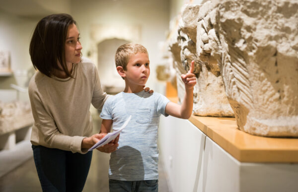 Attentive,Young,Woman,With,School,Age,Boy,Visiting,Sculptures,Exposition