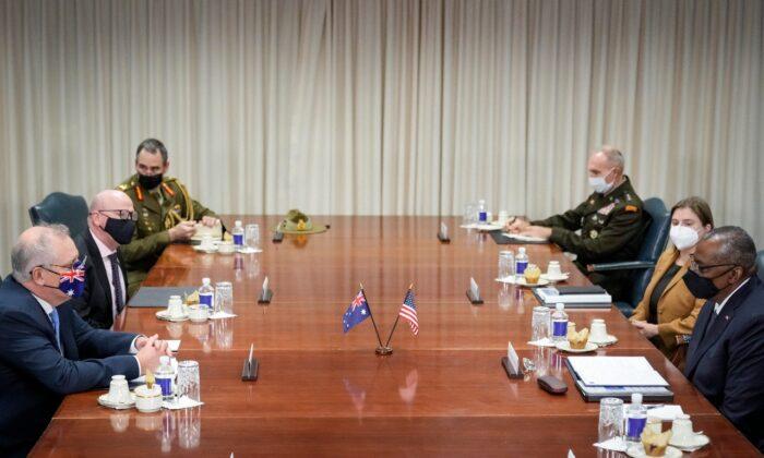 Prime Minister of Australia Scott Morrison (left) and U.S. Secretary of Defense Lloyd Austin (right) attend a meeting at the Pentagon in Arlington, Virginia, on Sept. 22, 2021. (Drew Angerer/Getty Images)