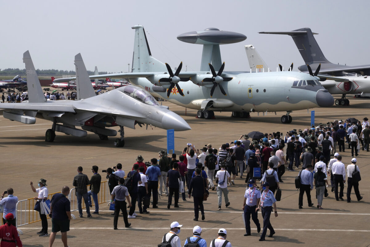 Visitors look at the Chinese military's J-16D electronic warfare airplane