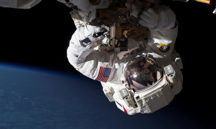 NASA Expedition 35 Flight Engineers Chris Cassidy (pictured) and Tom Marshburn (out of frame) conduct a spacewalk to inspect and replace a pump controller box on the International Space Station's far port truss (P6) leaking ammonia coolant, on May 11, 2013. (NASA/Handout via Reuters)
