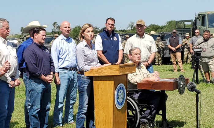 Iowa Gov. Kim Reynolds speaks at a press conference on the border situation while other governors look on, in Mission, Texas, on Oct. 6, 2021. (Marina Fatina/NTD)