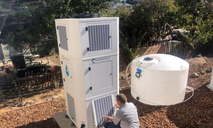 Ted Bowman, design engineer with Tsunami Products, installs a unit in homeowner Don Johnson's backyard in Benicia, Calif., on Sept. 28, 2021. (Haven Daily/AP Photo)