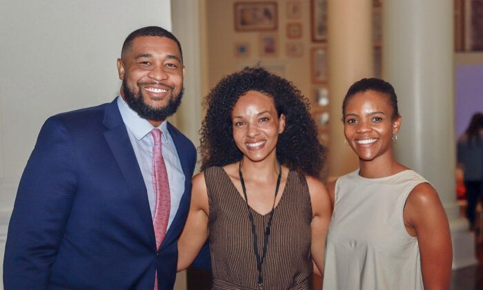"""Teacher Kali Fontanilla (C) stands with """"Blexit"""" founders Candace Owens (R) and Brandon Tatum (L). (Courtesy Kali Fontanilla)"""