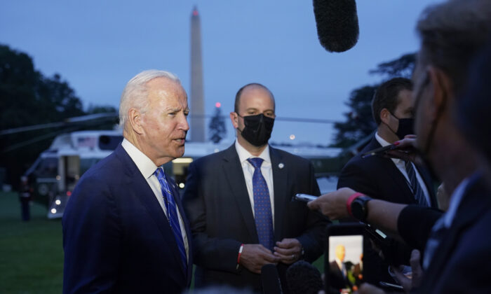 President Joe Biden talks with reporters after returning to the White House in Washington on Oct. 5, 2021. (Susan Walsh/AP Photo)
