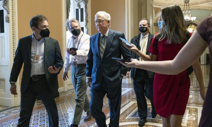 Senate Minority Leader Mitch McConnell (R-Ky.) walks to his office at the U.S. Capitol in Washington on Oct. 6, 2021. (Kevin Dietsch/Getty Images)