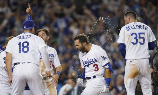 Taylor Hits Walk-Off HR, Dodgers Deck Cards 3-1 in WC Game