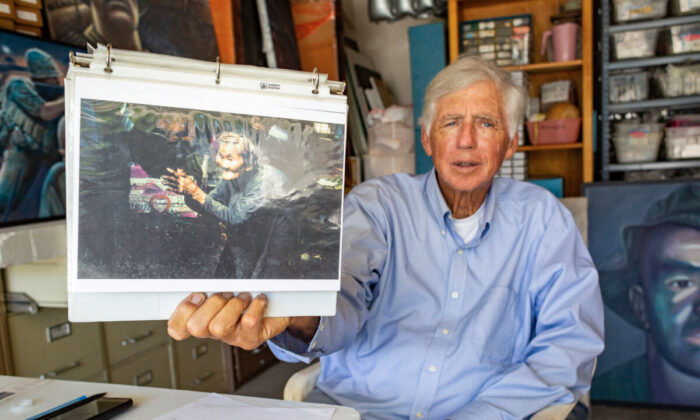 Former combat artist Ed Bowen displays one of his paintings in Newport Beach, Calif., on Sept. 14, 2021. (John Fredricks/The Epoch Times)