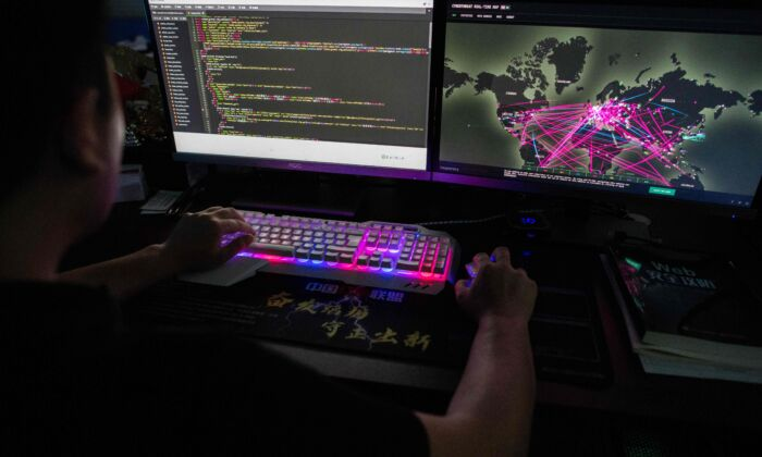 Prince, a member of the hacking group Red Hacker Alliance who refused to give his real name, uses a website that monitors global cyberattacks on his computer at their office in Dongguan, China's southern Guangdong province, on Aug. 4, 2020. (Nicolas Asfouri/AFP via Getty Images)