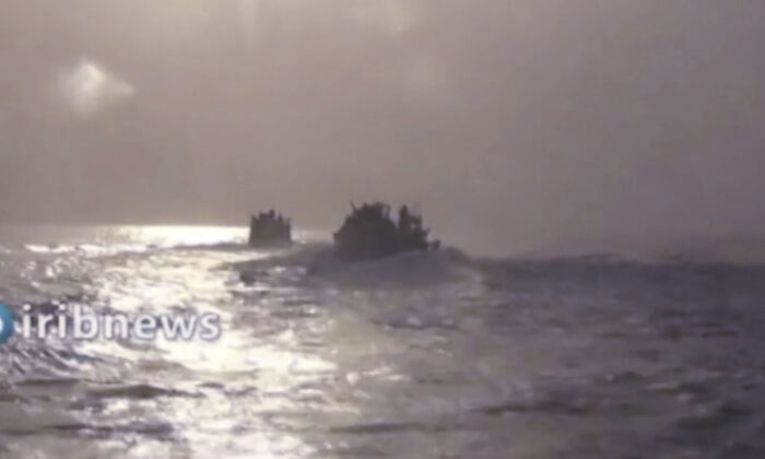 This frame grab from video aired by state-run TV Islamic Republic of Iran Broadcasting (IRIB) on Oct. 7, 2021, shows two vessels in the Persian Gulf. (IRIB via AP)