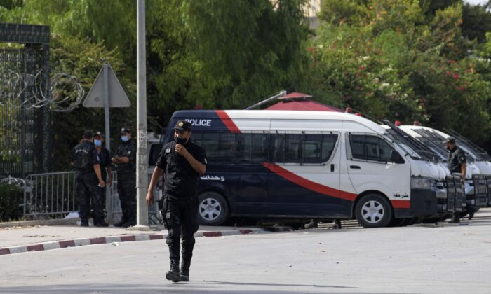 Tunisian police stand guard outside the parliament in Tunis on July 27, 2021. (Fethi Belaid/AFP via Getty Images)