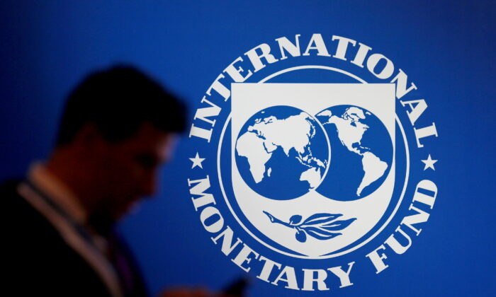 A participant stands near a logo of IMF at the International Monetary Fund—World Bank Annual Meeting 2018 in Nusa Dua, Bali, Indonesia, Oct.12, 2018. (Johannes P. Christo/Reuters File Photo)
