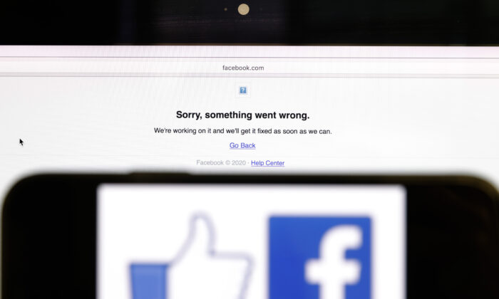 In this photo illustration, the Facebook logo is displayed next to a screen indicating a problem in San Anselmo, Calif., on Oct. 4, 2021. (Justin Sullivan/Getty Images)