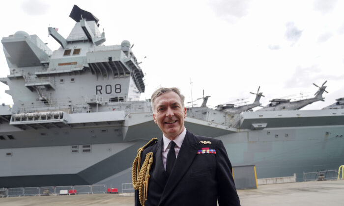 First Sea Lord Admiral Tony Radakin talks to media in front of the HMS Queen Elizabeth at HM Naval Base, Portsmouth, UK, on May 22, 2021. (Steve Parsons/PA)