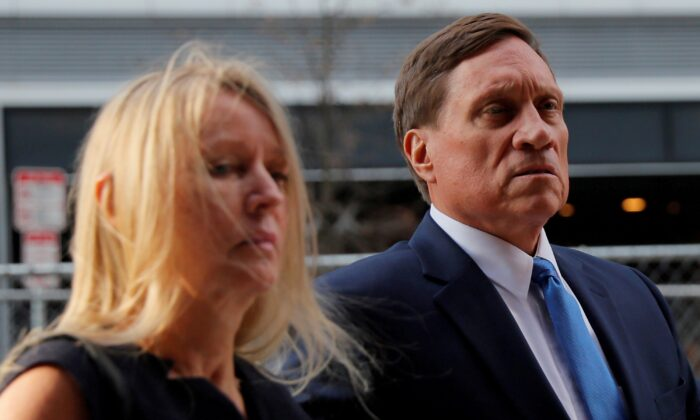 Private equity firm founder John Wilson arrives at federal court for the first day of jury selection in the first trial, in Boston, Mass., on Sept. 8, 2021. (Brian Snyder/Reuters)