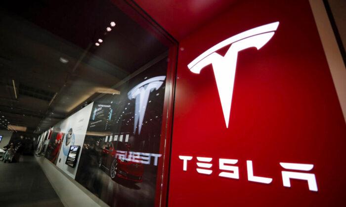 A sign bearing the company logo outside a Tesla store in Cherry Creek Mall in Denver, on Feb. 9, 2019. (David Zalubowski/AP Photo)