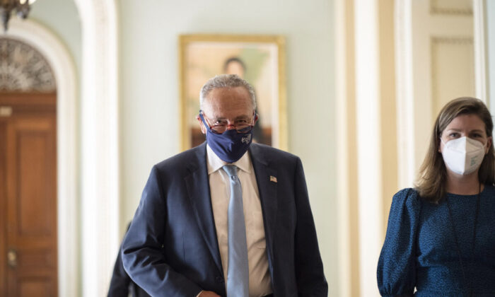Senate Majority Leader Chuck Schumer (D-N.Y.) walks to a lunch meeting with Senate Democrats at the U.S. Capitol in Washington, on Oct. 7, 2021. (Drew Angerer/Getty Images)