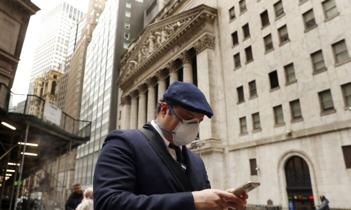 A man walks past the New York Stock Exchange on the corner of Wall and Broad streets in New York City, N.Y., on March 13, 2020. (Lucas Jackson/Reuters)