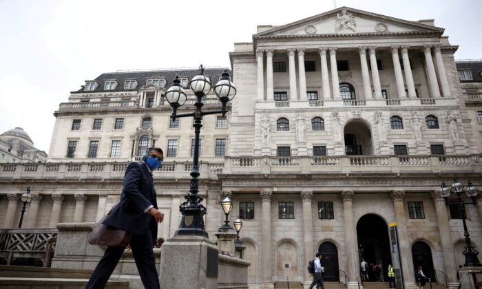 A person walks past the Bank of England in the City of London financial district, in London, Britain on June 11, 2021. (Henry Nicholls/Reuters)