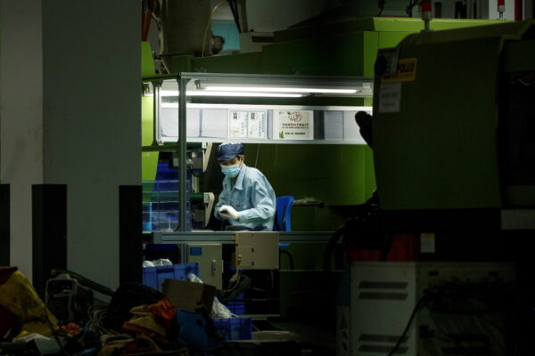 Man works at a manufacturing plant of Universal Electronics Inc in Qinzhou