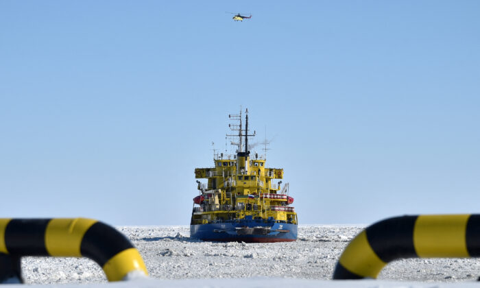 A picture taken on April 16, 2015 shows the icebreaker Tor at the port of Sabetta in the Kara Sea shore line on the Yamal Peninsula in the Arctic circle, some 2450 km of Moscow. The Yamal LNG (liquefied natural gas) project aiming to extract and liquefy gas from the Yuzhno-Tambeyskoye gas field is scheduled to start production in 2017. Russia's Novatek holds a 60 percent stake in the venture. France's Total and China's CNPC hold 20 percent each. (Kirill Kudryavtsev/AFP via Getty Images)