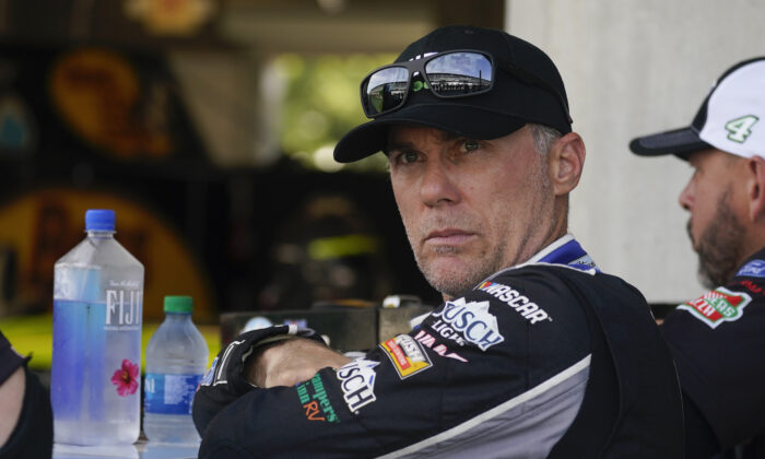 Kevin Harvick waits in his garage before practice for the NASCAR Cup Series at Indianapolis Motor Speedway in Indianapolis, Aug. 14, 2021. (Darron Cummings/AP Photo/)