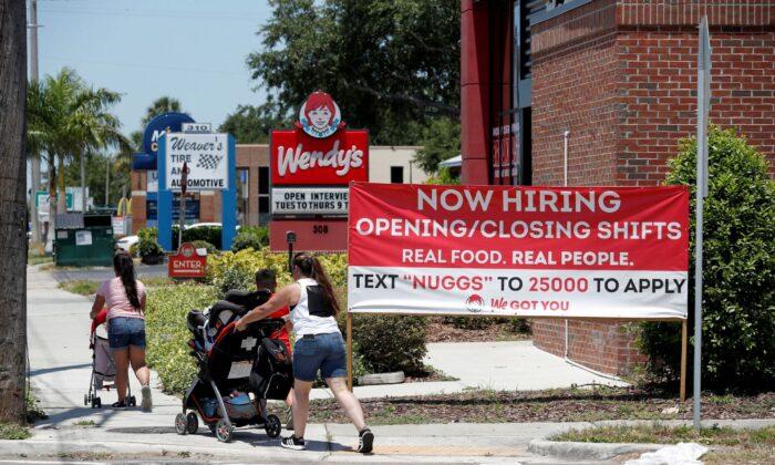 "A Wendy's restaurant displays a ""Now Hiring"" sign in Tampa, Fla., on June 1, 2021. (Octavio Jones/Reuters)"