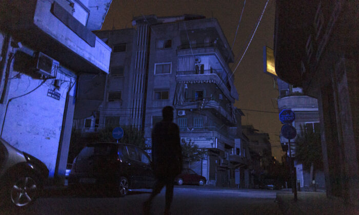 A man walks through Beirut during a blackout in Beirut, Lebanon, on Aug. 14, 2021. (Sam Tarling/Getty Images)