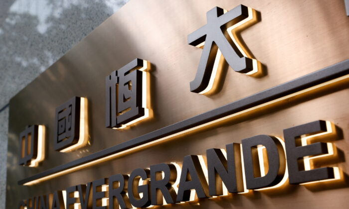 China Evergrande Center building sign in Hong Kong, on Sept. 23, 2021. (Tyrone Siu/Reuters)