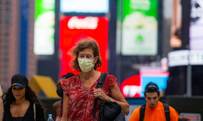 A woman wears a face mask in Midtown Manhattan in New York on July 29 2021. (Kena Betancur/AFP via Getty Images)