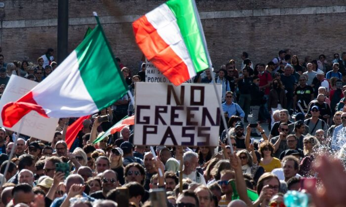 """People wave national flags during a protest against the mandatory """"green pass"""" in Rome, Italy on Oct.  9, 2021.  (TIZIANA FABI/AFP via Getty Images)"""